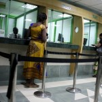 0011-customers-getting-served-over-the-counter-as-afya-centre-fosa-img-one